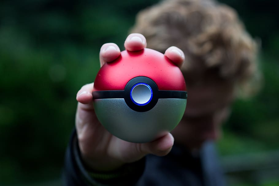 A person holding a Pokéball